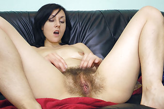 Kristy oils up and rubs herself down
