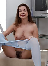 Pretty blue stockings make Edica's hairy pussy wet