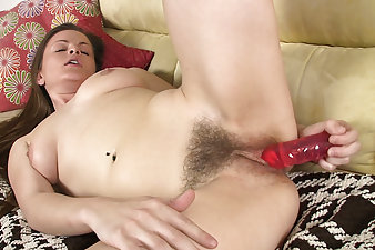 Sexy Ariel Heart rubs her wet pink pussy through her panties before laying back on the couch and driving her dildo into her box.