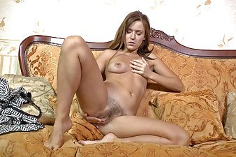 Hairy babe Era fingers pussy on couch