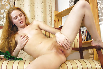 Nicole K plays with her hairy pussy after sexting