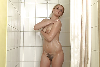 Hairy vixen Nika plays with her body in her shower
