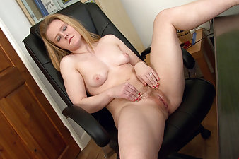 Hairy girl at the office takes a break