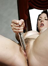 Angie fucks herself so hard with her vibrator that she comes all over the nice red lounge.
