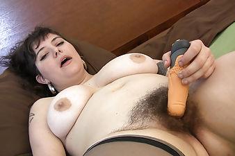 Esther toys her big fluffy bush