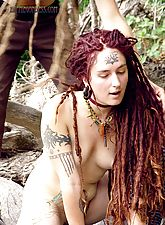 Cute hairy hippie girl with dredlocks plays nude on a log