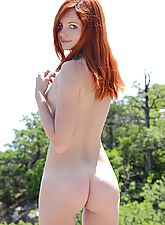 Fire red hair on this wild naked girl outside and running bare over anyone who gets in her way.