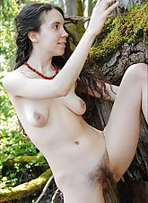 This natural naked hairy hippie girl bends and contorts in the forests and rivers of Oregon for the camera.