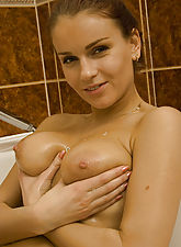 Big naturals, bathtub and a pink toy