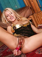 Beautiful blonde Mbali has got a new dildo and she can't wait to try it out on her moist, hairy pussy.