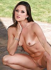 Stefanie Swift spreads her long hot legs in the backyard in here