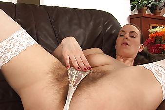 Horny Erin Eden rubs her hairy clit