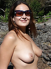 Big tits exposed in front of a car shop