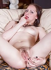 Be amazed as Lidiya pulls her leopard print panties to the side and slides fingers into her dripping wet hairy pussy.