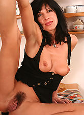 Tight bodied mature brunette enjoys her rubber friend